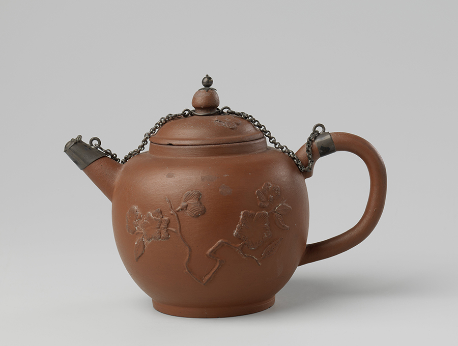 "Red stoneware teapot, with applique flora déco and ""Arij de Milde"" mark, Delft, the Netherlands, End of 17th century, Rijksmuseum, Amsterdam"