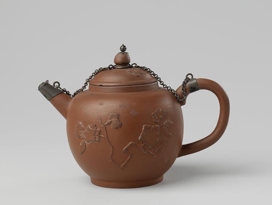 "Red stoneware teapot, with applique flora déco and ""Arij de Milde"" mark, Delft, the Netherlands, End of 17th century, Rijksmuseum, Amsterdam"